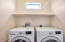Full Laundry Room with Washer & Dryer.