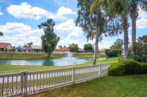 Golf & Water views from cozy East facing backyard!