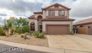 Amazing 2 story home with stunning arched entry and beautiful desert landscaping