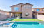 Sparkling pool and artificial turf on extended deep lot