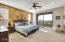 Large master bedroom with walk-out balcony