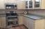 Kitchen with granite countertops.
