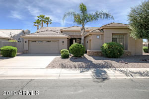 Stunning Sun Lakes home with golf course views on the 8th green of Ironwood Country Club! This home features a spacious living room with vaulted ceilings, plantation shutters throughout & a bonus den/office. The kitchen has upgraded granite counters, a kitchen island, & stainless steel appliances. The split floor plan offers total privacy & the master suite features a full walk-in closet, double vanity, walk-in shower, & soaking tub. Plenty of parking options with the main 2-car garage & attached 3rd car golf cart garage. The backyard is very low maintenance with a built-in BBQ, water fountain, & shady pergola. Iron fencing has been removed for sweeping landscape views. Don't miss this amazing opportunity in the active adult community of Sun Lakes!