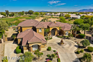 Custom home located in gated community on large 28,081 sq ft golf course lot