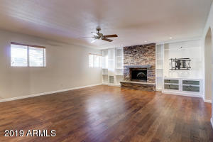 Family room with fireplace, built in units and wet bar