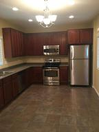 Stainless steel appliances with upgraded cabinets