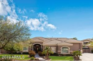 HUGE RV GARAGE attached to Custom home on cul-de-sac corner on a 1/2 acre lot! Gated community with friendly neighbors!