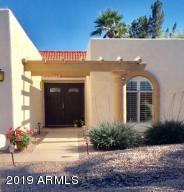 """Beautiful Elevation and """"Espresso' colored updated double doors."""