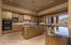 Elegant Kitchen has Newer Granite Counters, Sub-Zero Refrigerator and Walk-In Pantry
