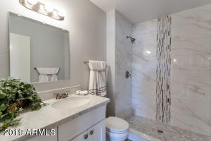Exquisite finishes include marble vanity.