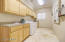 large laundry room w/sink & extra storage cabinets