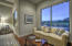 The master suite sitting area offers views of the golf course and mountains.