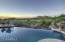 The patio and pool areas sit above the golf course, allowing for privacy.