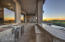 Enjoy the sunsets while sitting at the alfresco bar. Countertops with travertine and stacked stone surround, a serving sink and built in Monogram wine refrigerator make entertaining easy.