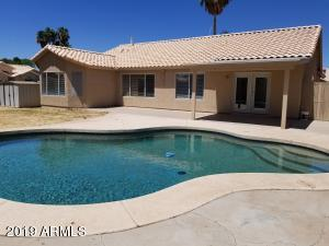 Jump into summer in your new home!'s pool. Cool off and relax on this large corner lot. Grass yard and pool area with no small stones to bother pool cleaner!