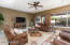 Overlooks resort style backyard with heated pool and outdoor built in bbq