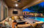 Large covered patio offers misters and overlooks heated pool and outdoor kitchen.