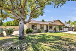 Large lot, expansive front lawn, beautiful mature shady tree.