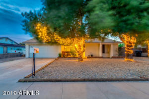 Great curb appeal with large shade trees
