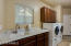 Large indoor laundry with granite counter tops with attached guest 3/4 bath.