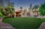 Large grassy area (artificial grass).