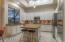 Undermount Lighting, Granite Counters and Stainless Backsplash