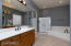 Master Bath has both tub and shower. There is a large walk-in closet behind the mirrored doors.