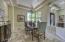 Corner windows bring an abundance of natural light into the formal dining room.
