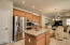 Gourmet kitchen with stainless steel double ovens