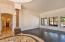 Hallway leads to formal dining room, great room, master bedroom, half bathroom, and garage.