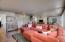 Wood laminate floors, neutral hues create a lovely , homey space.