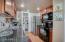 Granite counters, custom tile back splash and newer classic cabinets.