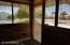 View from inside the screened porch. Privacy and a great conversation area.