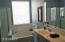 Separate tub and shower & vanity in master bath