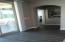 9-foot sliding doors to back patio, upgraded tile and entrance to master bedroom