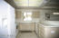 Tile flooring, side by side refrigerator with ice maker, east window for natural lighting.
