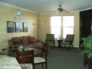 Spacious living room/dining room area with fireplace. Includes large screen TV and DVD player.