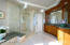 Separate enclosed shower.