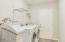 Inside spacious laundry room