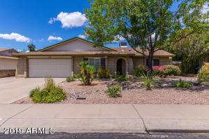 Highly maintained 4 Bed 2 bath North Tempe home on a Cul-De_Sac.No HOA! Numerous upgrades including electric fireplace, kitchen and bathrooms with granite counter tops and custom cabinets. Many builtins through-out. Ceiling fans and window coverings every room. Features include a water softener and R/O water systems. This home also features an attached 370 sq ft shop, man cave, she shed or game room with its own heating/cooling unit. Large covered patio with outdoor 4 hole putting green. Home features an active pest control contract (transferable). Easy access to 101/202 & 60 freeways, light rail , ASU and Skyharbor airport. A must see!!!