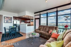 Wide open layout with floor to ceiling windows