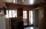 FRENCH DOORS TO PATIO 18 INCH TILE AND EAT IN KITCHEN AREA