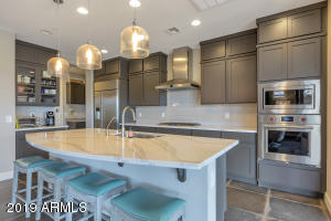 wow- upgrades-wolf oven-pendant lighting-breakfast bar and all open to living and dining
