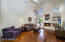 Soaring ceilings / fireplace and beautiful wood floors in the great room.