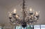 This custom chandelier hangs above the dining table