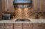 Beautiful solid woods cabinets and gorgeous backsplash