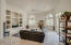 Family room with cantera front fireplace & TV area and book shelves