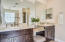 Double sinks with granite counter tops.