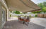 Electric, custom awning provides shade or sun on backyard patio! Perfect for outdoor dining.
