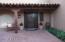 Courtyard with pavers. Custom front door.